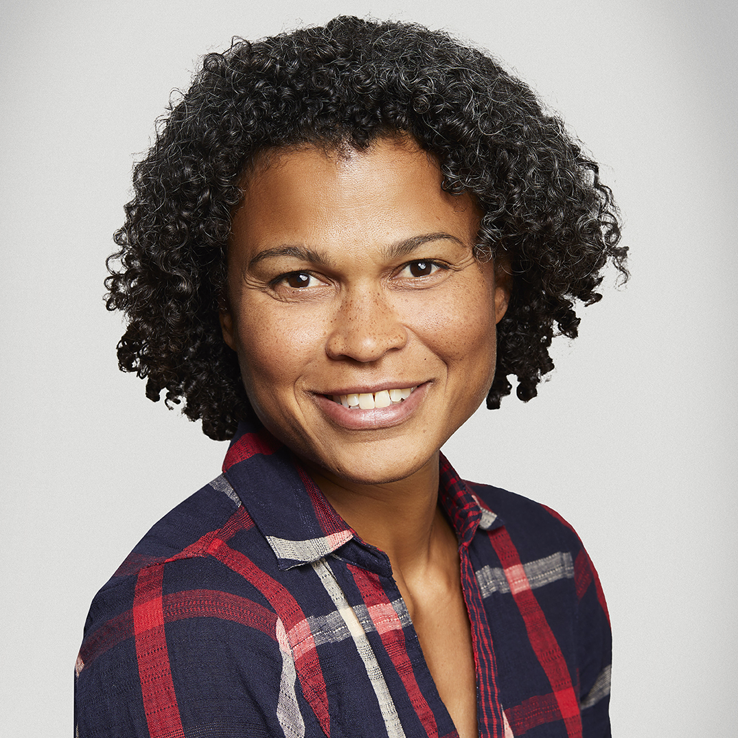 Headshot of a woman in a plaid shirt