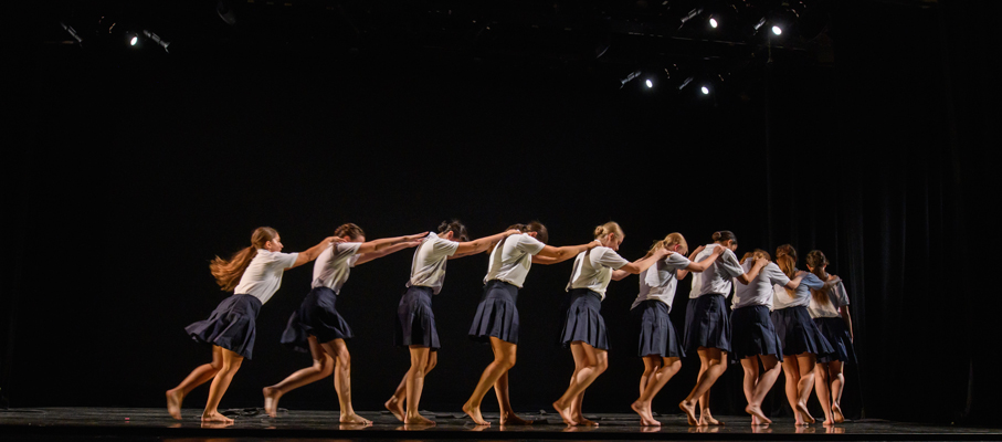 Dancers line up in a formation at the Fall '19 Faculty Concert.