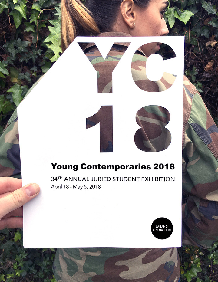 Young Contemporaries 2018 flyer being held over a student's camo-pattern jacket