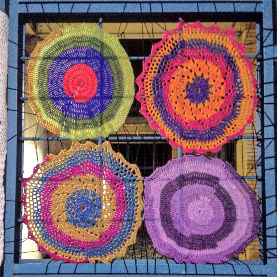 LMU staff Nicole Murph's crocheted circles in Dunning Courtyard made in collaboration with YarnBombingLA